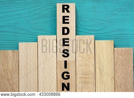 Redesign - Word On Wooden Bars On A Green Background. Business Concept