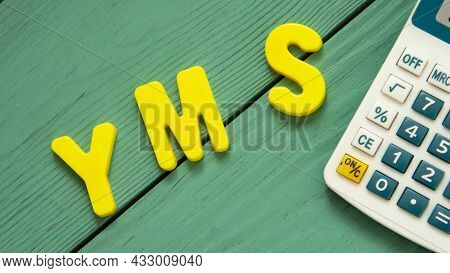 Yms - Acronym Is Lined With Letters Of The Alphabet On A Wooden Green Background.