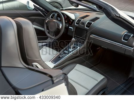 Interior Of Luxury Convertible Car, View From Passengers Door. Sport Car Cabriolet Interior With Whi