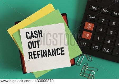 Cash Out Refinance - Words On Note Paper Against The Background Of A Calculator And Paper Clips. Bus