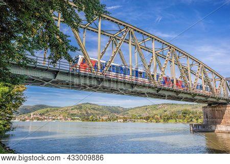 Train On Bridge Against Krems Town In Wachau Valley, Unesco World Heritage Site In Lower Austria, Au
