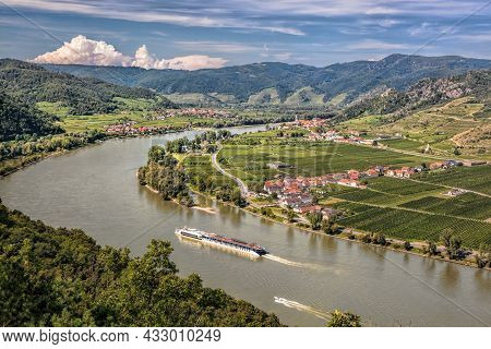 Panorama Of Wachau Valley (unesco World Heritage Site) With Ship On Danube River Against Duernstein