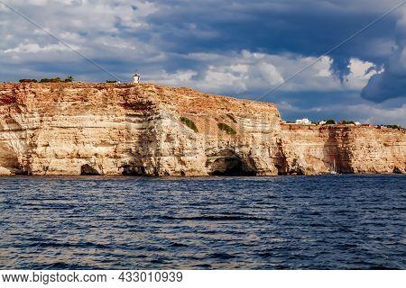 Black Sea Red Rocks Coastline. Coastal Red Rocks And Blue Sea. Seascape. Summer. Traveling.