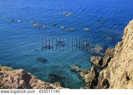 People Practicing Canoeing In The Reef Of The Sirens In Cabo De Gata, Almeria, Spain.