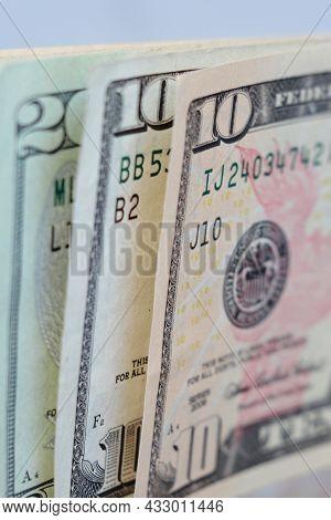 Upright Ten And Twenty Dollar Bills Closeup. Macro View. Shallow Depth Of Field