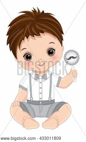 Cute Little Man Sitting Holding Rattle With Moustache Image. Cute, Brunette Baby Boy Wearing Fashion