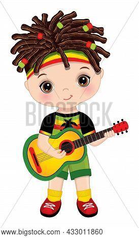 Cute Little Boy Wearing Rastafarian Outfit. Little Brunette Boy With Hazel Eyes And Dreadlocks Playi