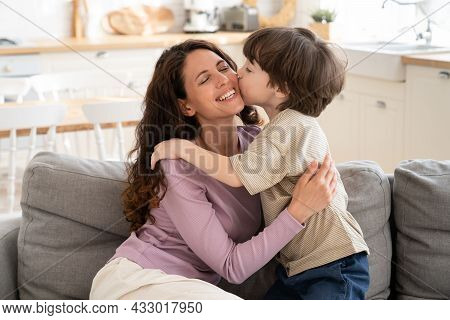 Small Boy Give Mom Tender Kiss In Cheek Embracing Single Parent Mum On Mother Day Or Greeting With B