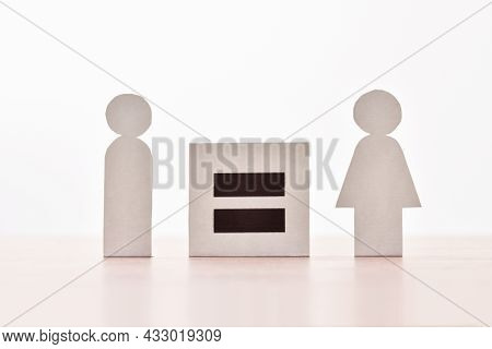 Equality Between Man And Woman With Equal Sign Between Two Paper Cutouts Shaped Like Man And Woman O