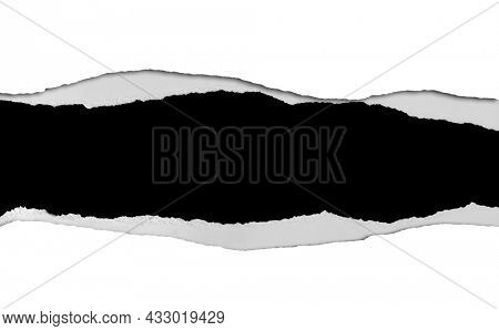 Ripped white paper on black background