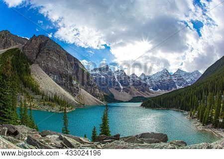 Picturesque and magnificent mountain lake Moraine. Canadian Rockies. The glacial lake is fed by glacier melt water and is located in the Valley of the Ten Peaks. Travel to northern Canada