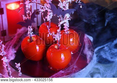 Halloween Dessert. Poisoned Blood Caramelized Glazed Candy Apple. Snow White Poison Lollipops.