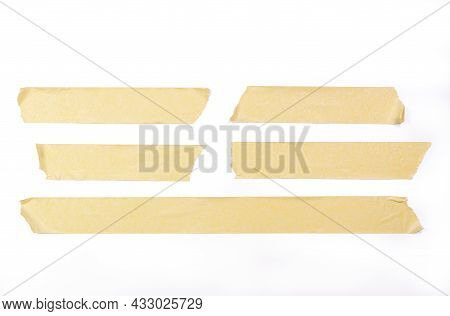 Adhesive Tape Pieces In Line On White Background, With Cliping Path