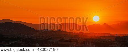 Panorama Of Amazing Beautiful Sunset Sunrise Over Dark Spanish Mountain Silhouette. Beautiful Sunset