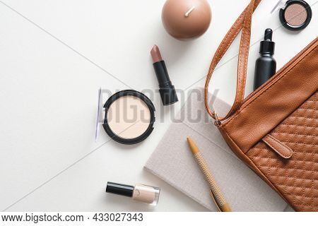 Makeup Cosmetics Products, Make-up Bag, Female Accessories On White Desk Table Top View.