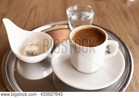 Traditional Turkish Coffee With Cold Water And Turkish Delight In Cafe. Selective Focus - Image