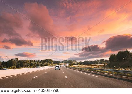 Movement Of Vehicles On Freeway, Motorway During Sunset Time.