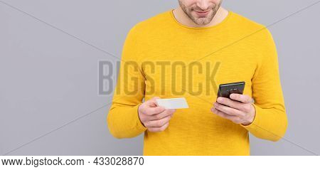 Man Cropped View Use Cell Phone Holding Credit Card Grey Background Copy Space, Mobile Payment