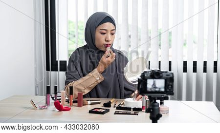 Asian Muslim Woman Beauty Blogger Tutorial By Lipstick Makeup On Her Mouth And Making Videos To Revi