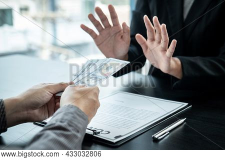 Close Up Of Man Employee Offering Bribe Money To Businessman To Signing The Contract To Joint Engage