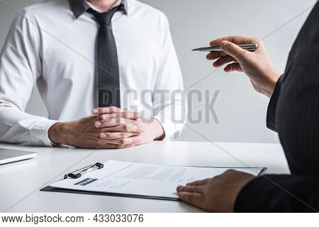 Employer Arriving For A Job Interview, Committee Listen To Candidate Answers Explaining About His Pr