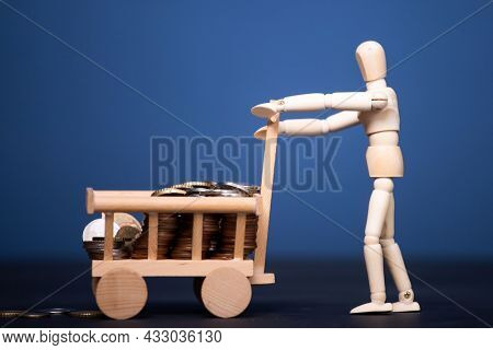 Wooden man carrying money. Business and finance concept