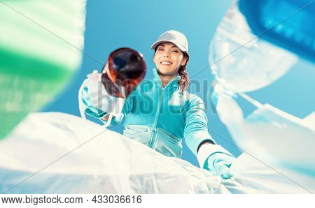 Happy Girl Holding Package For Garbage. Young Woman Volunteer, Participates In An Environmental Camp