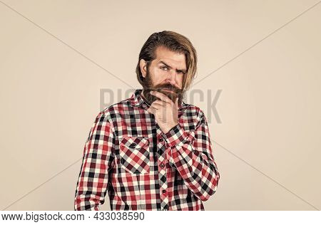 Thinking About Something. Bearded Man Wear Checkered Shirt. Confident And Handsome Brutal Man. Male