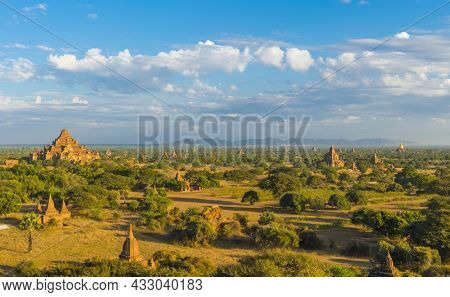 Late afternoon sun shines on Dhammayangyi Pahto Temple and many other pagodas in the ancient city of Bagan, Myanmar.
