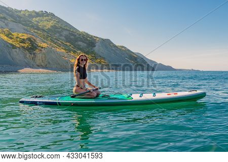 May 28, 2021. Anapa, Russia. Young Girl On Stand Up Paddle Board At Black Sea. Woman Vacation On Sup