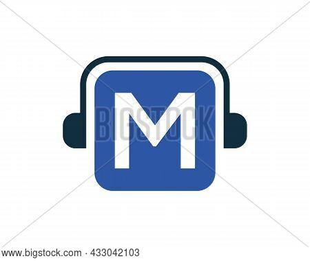 Headphone Logo On M Letter. Letter M Music Logo Design Template Headphone Concept