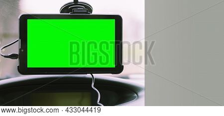 Car Navigator With Space For Text, Chroma Key. Navigator On The Windshield In The Car