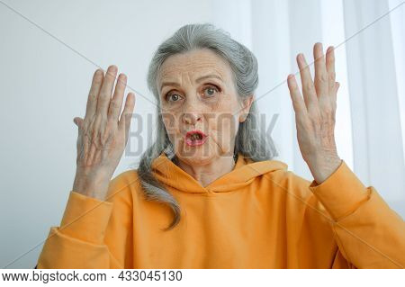 Closeup Portrait Of Angry Upset Senior Mature Woman Talking With Someone And Looking At The Camera.