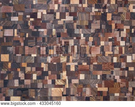 Background. Wooden Texture. Beautiful Wooden Mosaic Assembled From Wooden Pieces Of Different Textur