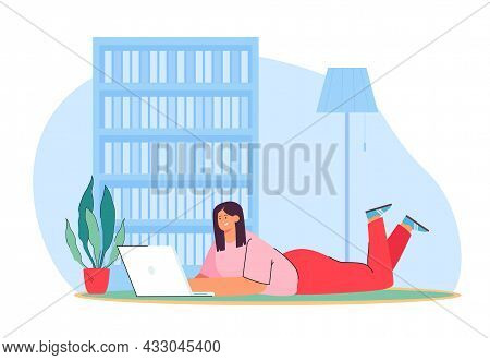 Happy Woman Lying On Floor With Laptop And Working From Home. Freelancer In Cozy Workplace, Girl Rel