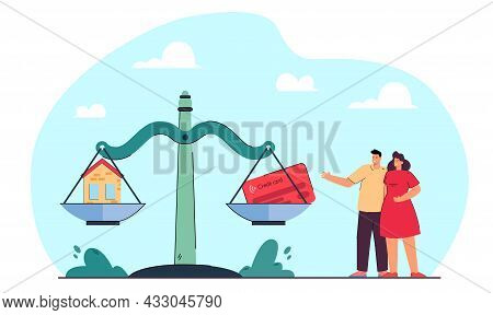 Married Couple Standing Next To Scales With House And Card. Husband And Wife Thinking Of Buying Real