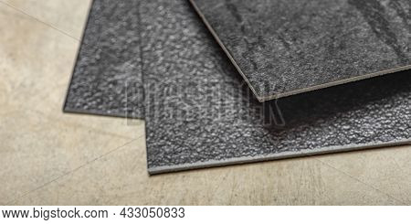 Vinyl Pvc Floor. The Texture Of The Vinyl Floor Is Black. Samples Of Vinyl Covering, Black Pvc Tiles