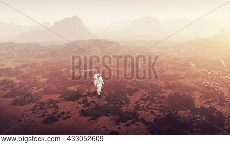 Astronaut doing space walk and explore a distant planet such as Mars. 3D render