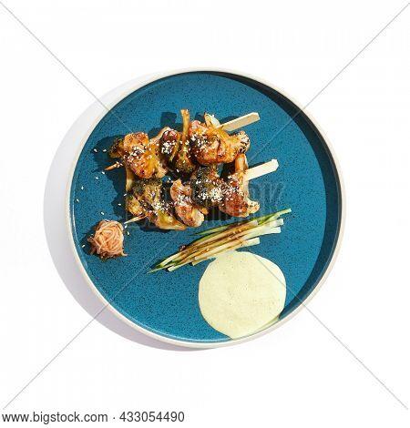 Vegetarian food - vegetables in skewers in teriyaki sauce. Grilled vegetables on bamboo stick in Japanese style. Vegan menu for asian restaurant. Eat less meat. Plant - based eating
