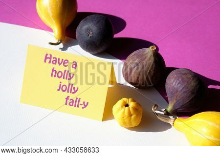 Text Have A Holly Jolly Fall-y On Paper Card. Autumn Colors. Purple Fig, Yellow Quince Fruits And Pu