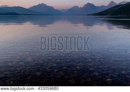 Smokey Hazy View Of Lake Mcdonald At Sunset In Glacier National Park