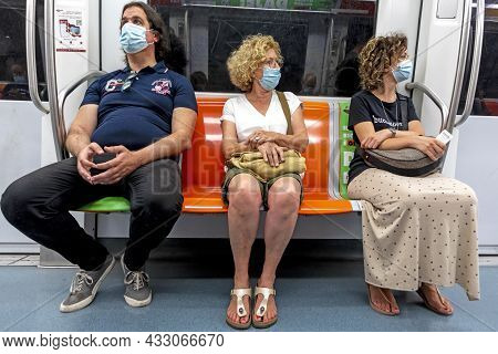 Rome, Italy - August 1, 2021: People In The Metro Protect Themselves By Wearing A Medical Mask In Ro