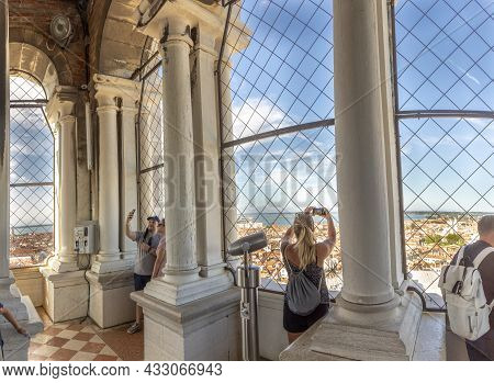 Venice, Italy - July 6, 2021: People Enjoy The Skyline From St. Mark's Cathedral To Skyline Of Venic