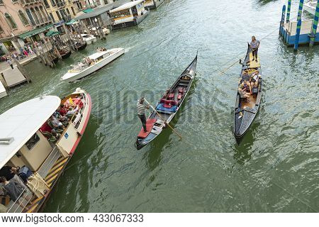Venice, Italy - July 1, 2021: Different Transportation Boats Like Taxi, Vaporetto And Gondola With T
