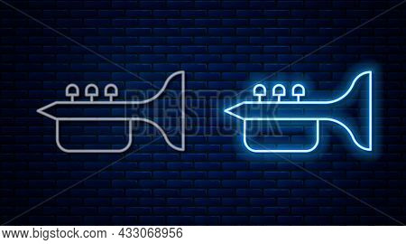 Glowing Neon Line Trumpet Icon Isolated On Brick Wall Background. Musical Instrument Trumpet. Vector