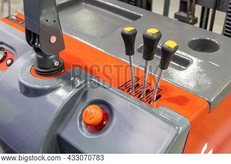 Electric Forklift Controls. Control Console With Handles And Buttons Close-up