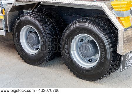 Trucking Concept. Rear Wheels Of A Clean Truck With Bridgestone L355 Tires. New Tubeless Truck Tires