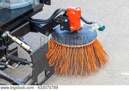Rotating Brushes Of A Compact Municipal Sweeper For Cleaning Narrow Driveways And Sidewalks
