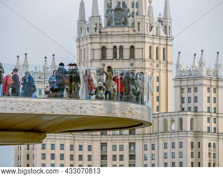 An Unusual View Of The Soaring Bridge In Zaryadye Park. Close-up Of Tourists On The Floating Bridge