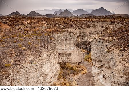 Tuff Canyon And Chisos Mountains On Cloudy Day In Big Bend National Park